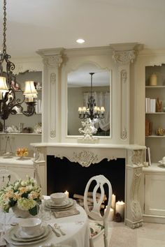Beautiful creamy French inspired space by Beverly Ellsley. I love the fireplace with the candles burning in it- good idea to brighten that dark hole in the warm months.