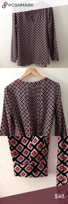 Pleione Pleat Back Split Neck Top Silky patterned blouse with front split neck and pintuck pleats in the back. Long buttoned sleeve cuffs can be rolled up. Light and airy, moves easily. Looks chic tucked into a pair of skinnies. Worn once. Pleione Tops Blouses