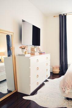 home decor bedroom Spring Bedroom Decor, floral pillows Apartment Bedroom Decor, Home Bedroom, Bedroom Ideas, Bedroom With Tv, Floral Bedroom Decor, Tv Stand For Bedroom, Master Bedroom, Bedroom Tv Wall, Bedroom Setup