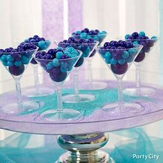 Sip on this sweet & chic way to display candy at a bridal shower or milestone birthday party. Mix coordinating gumball colors in mini martini glasses!