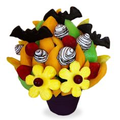 Batty Berry Blossom Share the spookiness of Halloween with the Batty Berry Blossom! Trick or treat yourself to chocolate covered bat-shaped pineapple, plain daisies, strawberries, oranges, cantaloupe and white chocolate dipped strawberries with a milk chocolate swirl!