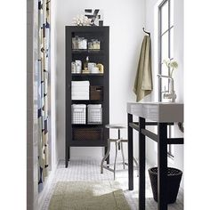 """Shown above from left to right:  1. Sterling 70"""" Tall Cabinet, $899.00 from Crate & Barrel  2. Klingsbo Glass-door cabinet, black, clear glass, $129.00 from Ikea  3. Multiple Shelf Glass Cabinet, $(Contact for pricing) from Neelam Furniture  4. Pharmacy Bath Cart, $399.00 from Pottery Barn  5. Mid-Century Modern Metal Bookcase, $595.00 from I Find U Buy"""