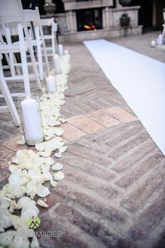 White rose petals line the aisle for an outdoor ceremony | Lasting Images Photography | villasiena.cc