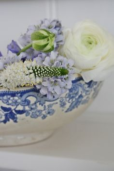 Pretty soft blue and white bowl filled with fresh flowers - so delightful to behold.    ZsaZsa Bellagio
