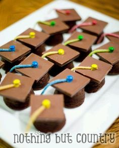 Brownie bites topped with chocolate square, M&M and candy ribbon