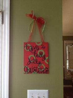DIY Christmas Decor  like the ribbon holding up a canvas...could do a retro xmas print and it would be pretty cute!