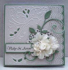 The cut outs tie in the card so much more than leaving the embossing intact. What a lovely card this is.