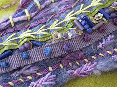 purple and blue ribbons, stitches and beads