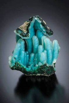 This stunning specimen is described as Chalcedony on Chrysocolla stalactites From Ray Mine, Ray, Pinal County, Arizona. Scott Rudolph collection and photo: Jeff Scovil Visit Amazing Geologist for more. Image may contain: food Minerals And Gemstones, Rocks And Minerals, Blue Gemstones, Rock Collection, Beautiful Rocks, Mineral Stone, Rocks And Gems, Stones And Crystals, Gem Stones