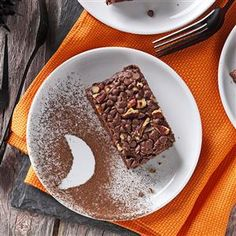 Devil's Food Snack Cake Recipe -My husband and his friends request this cake for camping trips because it's easy to transport. To create a fun motif on the plates, trace a shape onto paper and cut out. Hold the stencil over a plate and dust with cocoa powder. —Julie Danler, Bel Aire, Kansas