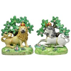 Pair of antique Staffordshire pottery figures of the Lion and Unicorn