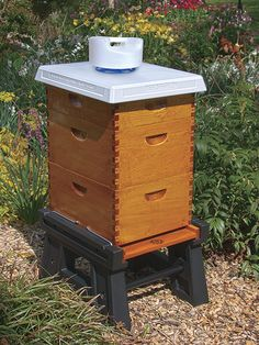 Bee Smart Design's Hive Stand, Hive Cover and Hive Top Feeder! All products & more can be found at our website BeeSmartDesigns.com  #hivestand #hives #hive #hivecover #hivefeeder #bee #bees #beekeeper #beekeeping #beekeeperlife #apiary #apiaries #englishgarden #garden #beefarm #beesmart #pollination #honey #nector
