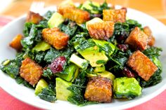 2 bunches of kale,washed Juice of 2 lemons 1 eight oz package of tempeh, cubed 1/3 cup organic coconut oil 1/3 cup organicolive oil 1/8 tsp. sea salt 1/3 cupdried cranberries 1/4 Parmesan cheese, grated 1