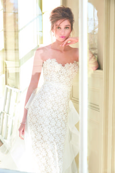Ivory Venise lace sheath bridal gown, strapless sweetheart bodice, cashmere lining and sparkle tulle underlay, low back, detachable Watteau train with tiered horsehair hem detail and chapel train.