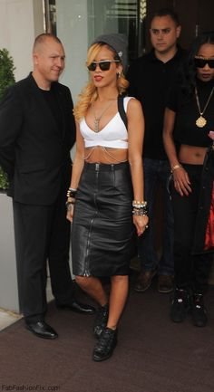 Rihanna street style with crop top, leather skirt and Balenciaga sneakers. #rihanna