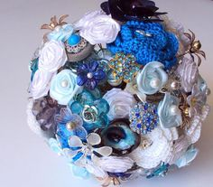 Beautiful and creative handmade wedding bouquet, vintage, jewels, brooches, satin, pearls, beads and a crocheted flower