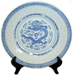 "Traditional Dragon Blue and White Rice Grain Patterned Porcelain Plates - 8""D by Reorient. $23.41. Dishwasher and microwave safe. Traditional Chinese dinnerware design with dragon. Set of 4 rice pattern plates, stands not included. Traditionally hand crafted in China. Size: 8""D. This traditional Chinese design is made of durable porcelain and is food, dishwasher and microwave safe. Commonly called RICE PATTERN, it is named after the tiny translucent windows that adorn the porcela..."