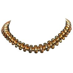 Bulgari Caltaura Necklace. BULGARI Caltaura Necklace with a flexible design, composed of domed links, worked in  750/- Yellow Gold/-White Gold/-Red Gold