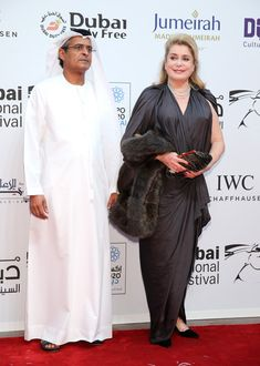 """Catherine Deneuve Photos Photos - DIFF Chairman Abdulhamid Juma and Catherine Deneuve, who receives a Lifetime Achievement award attend the Opening Night Gala of """"Room"""" during day one of the 12th annual Dubai International Film Festival held at the Madinat Jumeriah Complex on December 9, 2015 in Dubai, United Arab Emirates. - 2015 Dubai International Film Festival - Day 1"""