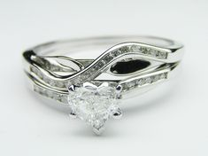 Petite Swirl Design Heart Shape Engagement Ring with Channel Set Round Diamond Accents
