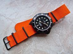 Steinhart black PVD Ocean on orange nato strap