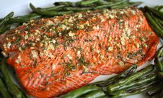 Preheat oven to 425F. Peel and chop garlic. Set aside. Chop the rosemary. Set aside. Place salmon on a baking sheet. Note: cover with foil because it's easier to clean. Distribute olive oil evenly …