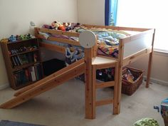 ikea loft bed with slide, my kids would love this. :)