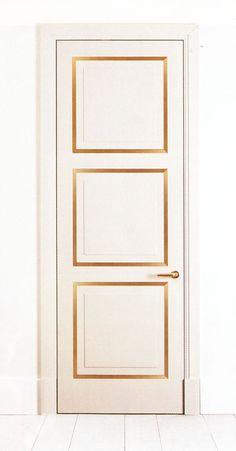White and gold frame door. -- great idea for dressing room or dining room detailing