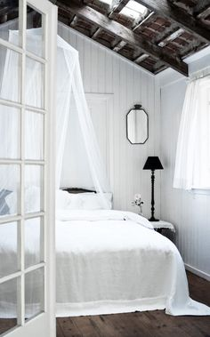 = white netting and linens, skylight and beams