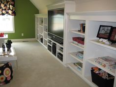 Great attic organization ideas with this built in bookshelf.