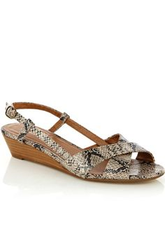These snake print sandals have a small wedge heel and a buckle fastening to the back.