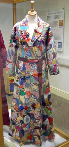 I ❤ crazy quilting & embroidery . . .Crazy Patchwork Dressing Gown~ Dressing gown with shawl collar, raglan sleeves and a fitted waist, with an A-line skirt and a patch pocket. The crazy patchwork has been made from cotton, silk and rayon in many different colours and embroidered over the seams.The lining is thought to have been made from parachute silk. Circa 1940-1950, Quilt Museum and Gallery, York