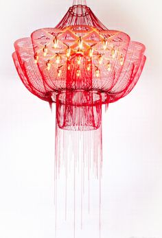 This is a chandelier that will light up a room, not just illuminate it. Architectural yet draped, you can have the best of many design worlds