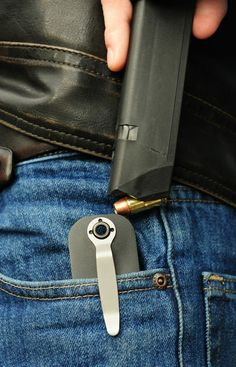 The Snagmag is a cool piece of gun gear that allows you to carry a spare magazine in your pocket. It's a great alternative to a standard ammo pouch. And it looks like a pocket knife Guns N Roses, Camouflage, By Any Means Necessary, Cool Guns, Doomsday Prepping, Guns And Ammo, Weapons Guns, Tactical Gear, Tactical Knife