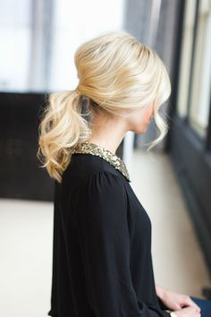 Holiday ponytail how-to! We're talking tousled curls, body, and one totally gorgeous updo hairstyle. You'll be turning heads with this statement-making look. Click to follow this step-by-step holiday hairstyle tutorial.