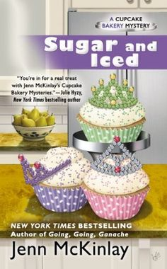 Sugar and Iced: Cupcake Bakery Mystery #6 by Jenn McKinlay. Normally Melanie Cooper and Angie DeLaura wouldn't be caught dead at a beauty pageant, but when Mel's mom asks them to provide cupcakes for the seventy-fifth annual Sweet Tiara contest as a favor for her best friend, they can't say no.