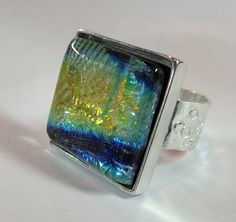 Dichroic Fused Glass Cabochon with fine silver band and sterling silver bezel. Handmade by Monica