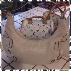 """Priced to Sell  Michael Kors Leather Purse Gorgeous cream leather Michael Kors purse. Medium size bag with lots of accent buckles. Great used condition with minimal wear reflected in price. Could use a light cleaning. Great find. Measures 8"""" deep, 13"""" wide, bottom width measures 3"""". Michael Kors Bags"""