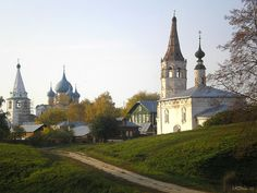 Suzdal (Russia). 'Gently winding waterways, flower-drenched meadows and domespotted skyline make this medieval capital a perfect fairy-tale setting. Suzdal was bypassed by the railway and later protected by the Soviet government, all of which limited development in the area. Nowadays, its main features are its abundance of ancient architectural gems and its decidedly rural atmosphere.' http://www.lonelyplanet.com/russia/golden-ring/suzdal