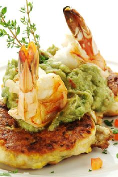 Try Our Pan Fried Crab Cakes Topped with Avocado Cream and Shrimp