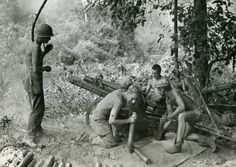 WWII soldiers throw mortar shells at the enemy in the jungles of Burma. Photographer Yarnell