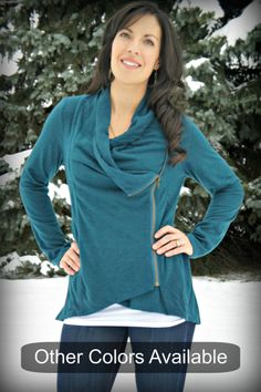 Trendy, comfy sweatshirt with side zipper and cowl neck in teal.$46  www.limestreetfashion.com  #sidezipper  #sweatshirt