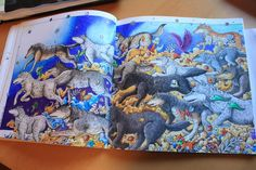"""Aurora Wolves"" from the Animorphia colouring book by Kerby Rosanes. Coloured by Anne Harwood"