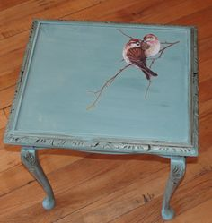 (Lovely little table done in Annie Sloan Provence with a bird transfer finished in clear and dark wax.) The birds are adorable. ~C