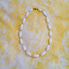 """Vintage 1970's Trifari Beaded Necklace White beads with small brass bead dividers. Unique design! Necklace measures 24"""" long. Beads are 3/4"""" wide at center.  See photo #3 for Trifari logo imprint. Some slight wear on certain beads as this costume jewelry is vintage! Trifari Jewelry Necklaces"""
