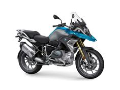 The 2019 BMW debuts with a new engine that features variable valve timing, though few other changes come to the popular adventure-tourer. Best Gas Mileage, Motorcycle Manufacturers, Bmw S, New Motorcycles, New Engine, Cylinder Head, Brake Calipers, Wheel Cover, Motorcycle Bike