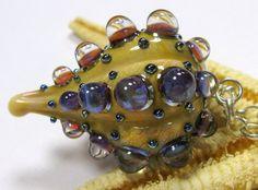 "SMAUGGS handmade lampwork bead ""Dragonfruit"" (42mm x 26mm), glass, ivory, purple, loop 4mm. $33.99, via Etsy."