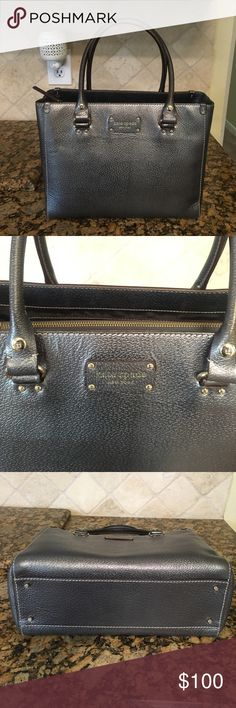 Metallic silver Kate Spade tote Beautiful authentic Kate Spade tote in metallic silver color. Good condition inside and out. Love how this bag stands on its own and does not slouch. kate spade Bags