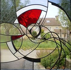 66 x 66 cm: stained glass and decorated with pieces of lead  by Yvonne Veen at Glinsterend Glas
