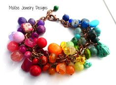 Chunky rainbow gemstone and copper bracelet.  Made of mixed gemstones in the rainbow color pattern with copper metal chain.  $58.00